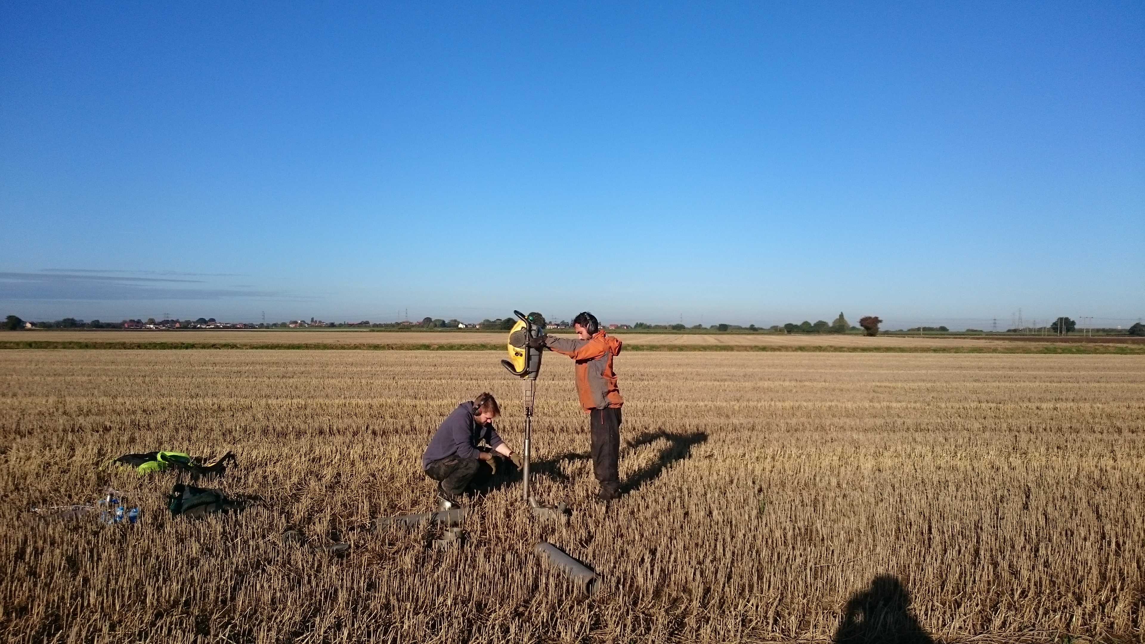 Coring for soil carbon assessment.
